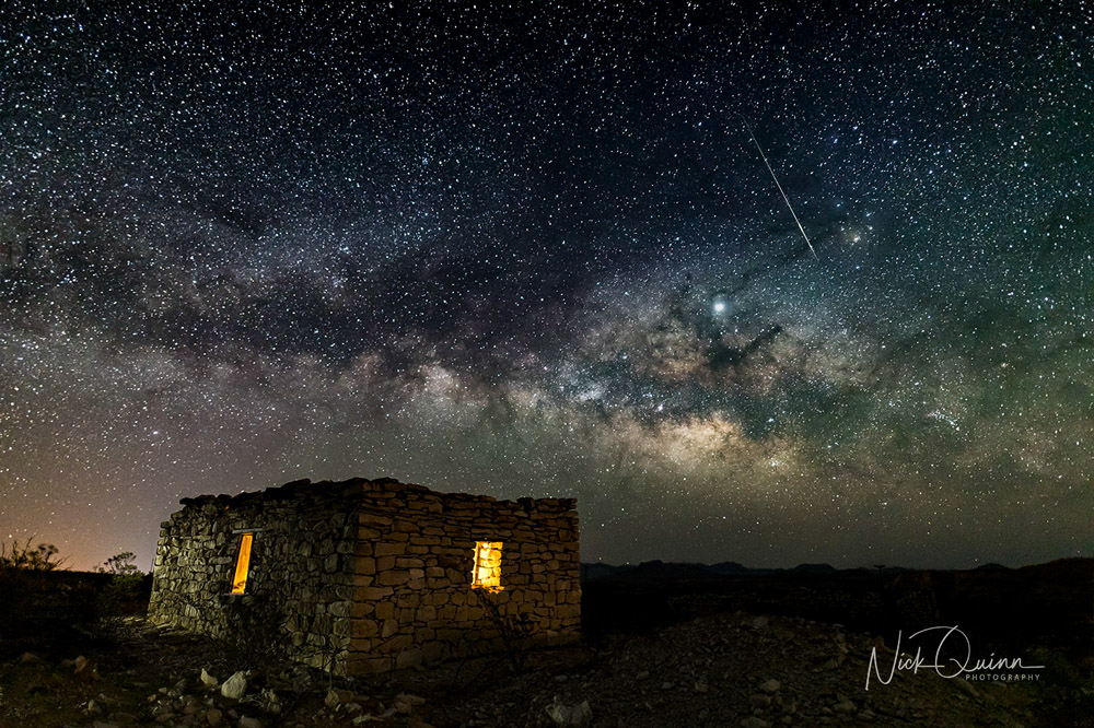 Old stone mining ruins with Milky way behind it.